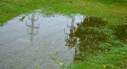 too compact and impermeable soil does not absorb water during rains and floods. a lake was created in the park in the lawn, which gradually infiltrates. damage to the lawn long flooding.  water push