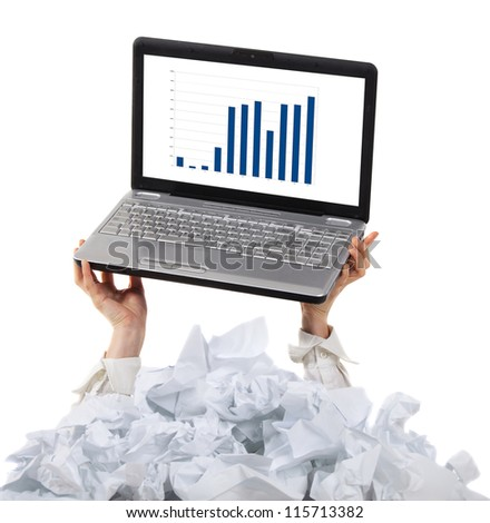 Too many paper work. Hands of woman holding her laptop over papers