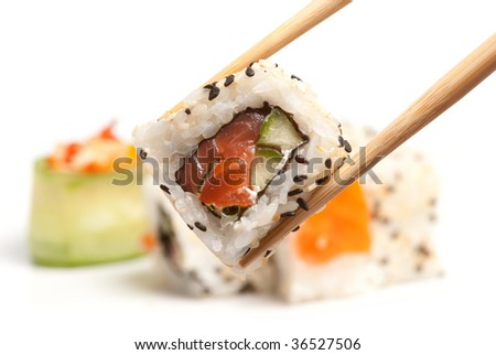 Took a sushi roll by the chopsticks