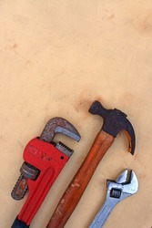 Tool and repair. Old Hammer, Adjustable wrench and monkey wrench on wood background