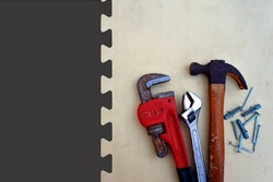 Tool and repair. Old Hammer, Adjustable wrench, monkey wrench and nails on wood background. Empty space for design.