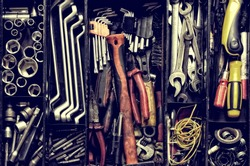 Tool box. Toolset with interior compartments to keep wrenches, ring spanners, hammer, pliers, screwdrivers, monkey wrenches, screws, bolts, wire and other do-it-yourself (DIY) tools.