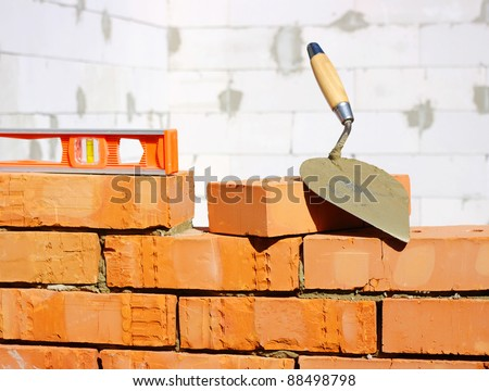 Tool for laying and bricks