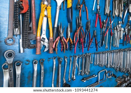 tool mounted on the wall, technical background #1093441274
