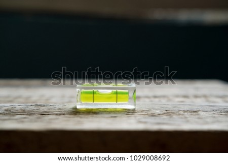 tool small building level lies on a wooden surface