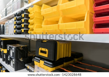 Tool Storage Box and Tool Chests Protective cases for tools and devices.colorful plastic Storage boxes on Shelf for accessories or tools set in home office or garage ,