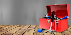 Toolbox with various work tools on the desk
