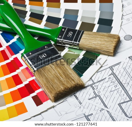 tools and accessories for home renovation on an architectural drawing
