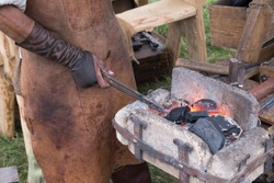 Tools and accessories of the ancient blacksmith forge with air fur blowing