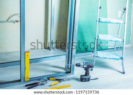 tools and equipment for plasterboard mounting Stack of drywall metal profiles.  #1197159736