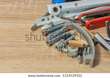 Tools and fasteners for furniture assembly #1314529502