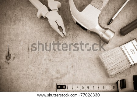 tools and instruments on wood board on sepia