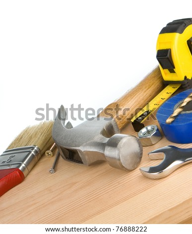 tools and instruments on wooden brick isolated at white background