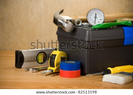 tools and toolbox on wood texture