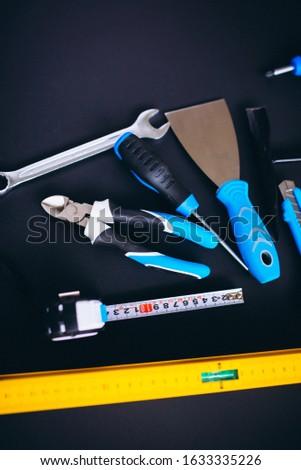 Tools background, set of tools on black background