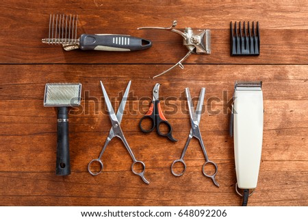 tools for dog grooming on the wooden surface of the table