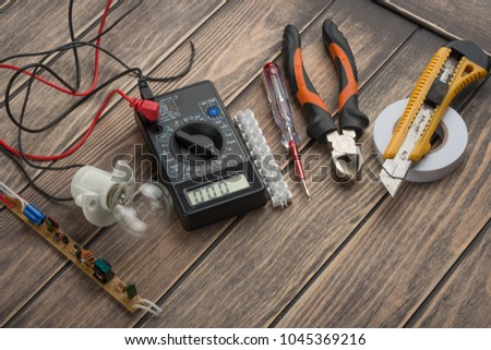tools for electricians. On a wooden background. View from above, with space for writing or advertising #1045369216