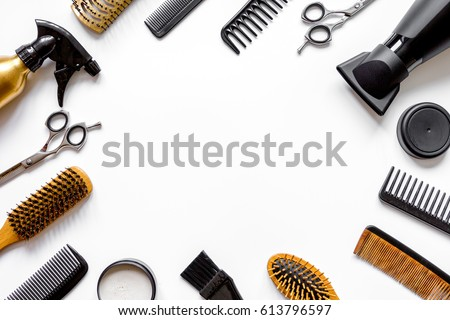Tools for hair styling on white background top view #613796597