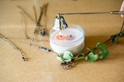 Tools for making candles of white soy wax flakes, essential oil, wicks on pergament background. Flat lay, overhead shot. Ecological lifestyle Soy wax, wick, cap, lavender - ingredient for handmade