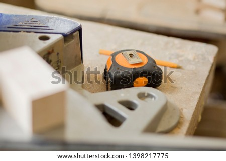 Tools for repair. Сonstruction tools on a wooden board maintenance concept.