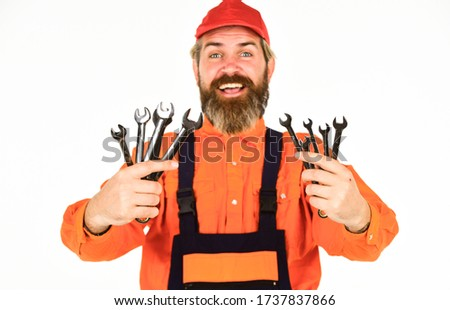 Tools for repair. Replacement parts. Man hold wrench tools. Wrench tool. Automotive Service Technicians and Mechanics. Heavyweight work is on larger machines or heavy equipment. Professional tools.