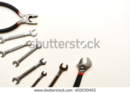 Tools for repairing top view on white background, space for text #602030402