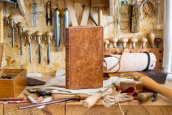 Tools for the craft of hand bookbinding in workshop