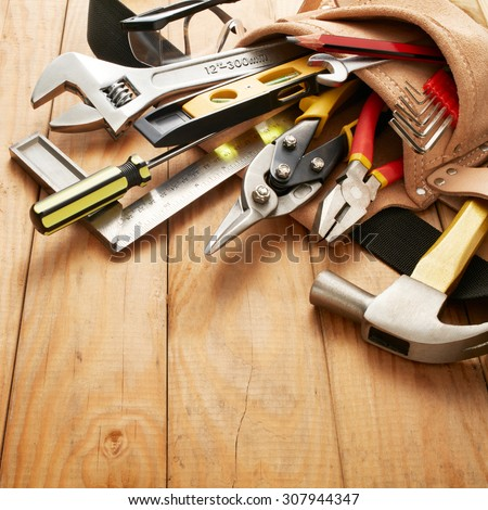 tools in tool belt on wood planks #307944347