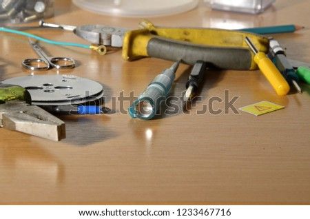 Tools on a workbench, tools on a wooden table, a set of tools #1233467716