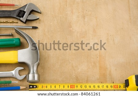 tools on wood texture background