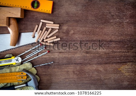 tools on wooden background #1078166225