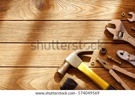 Tools on wooden background with copy space #574049569