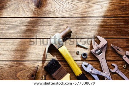Tools on wooden background with copy space #577308079