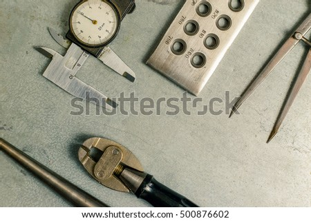 Tools set of jewellery. Jewelry workplace on metal background with copy space for text. Top view. Toned
