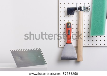 Tools Used For Wall Plastering Hanging On A Pegboard