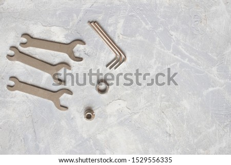 tools, wrenches, hex wrenches on concrete background, top view #1529556335