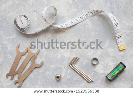 tools, wrenches, hex wrenches on concrete background, top view #1529556338