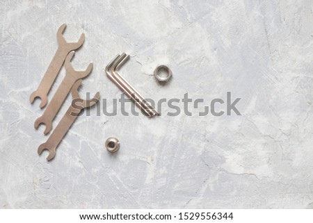 tools, wrenches, hex wrenches on concrete background, top view #1529556344