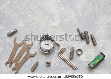 tools, wrenches, hex wrenches on concrete background, top view #1529556350