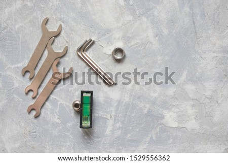 tools, wrenches, hex wrenches on concrete background, top view #1529556362