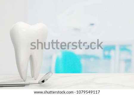 Tooth and Dental mirror. #1079549117