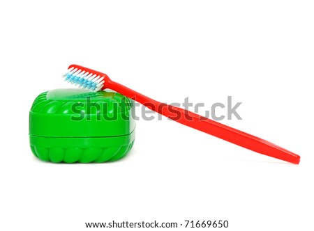 tooth brush and  soap isolated on a white background