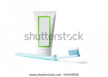 Tooth brush and tooth paste isolated on white background