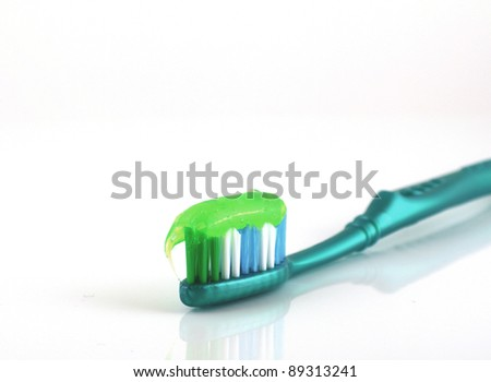 Tooth-brush with tooth paste over white