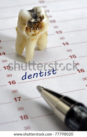 tooth with dental caries and dentist date in calendar