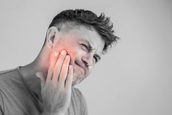Toothache, medicine, health care concept, Teeth Problem, young man suffering from tooth pain, caries