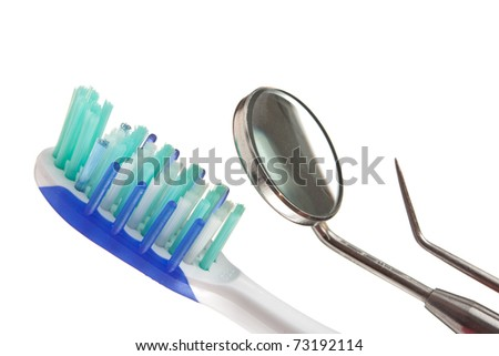 toothbrush and dental Instruments isolated on a white  background - stock photo