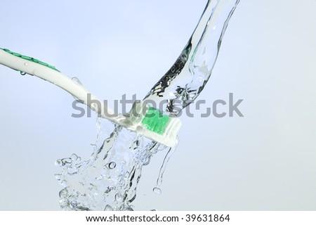Toothbrush and splashing water. Health care