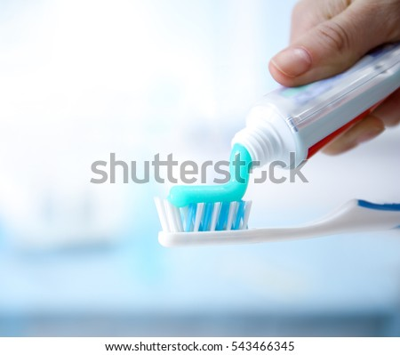 Toothbrush and toothpaste on blurred background Foto stock ©