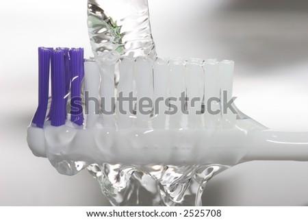 toothbrush closeup under water tap